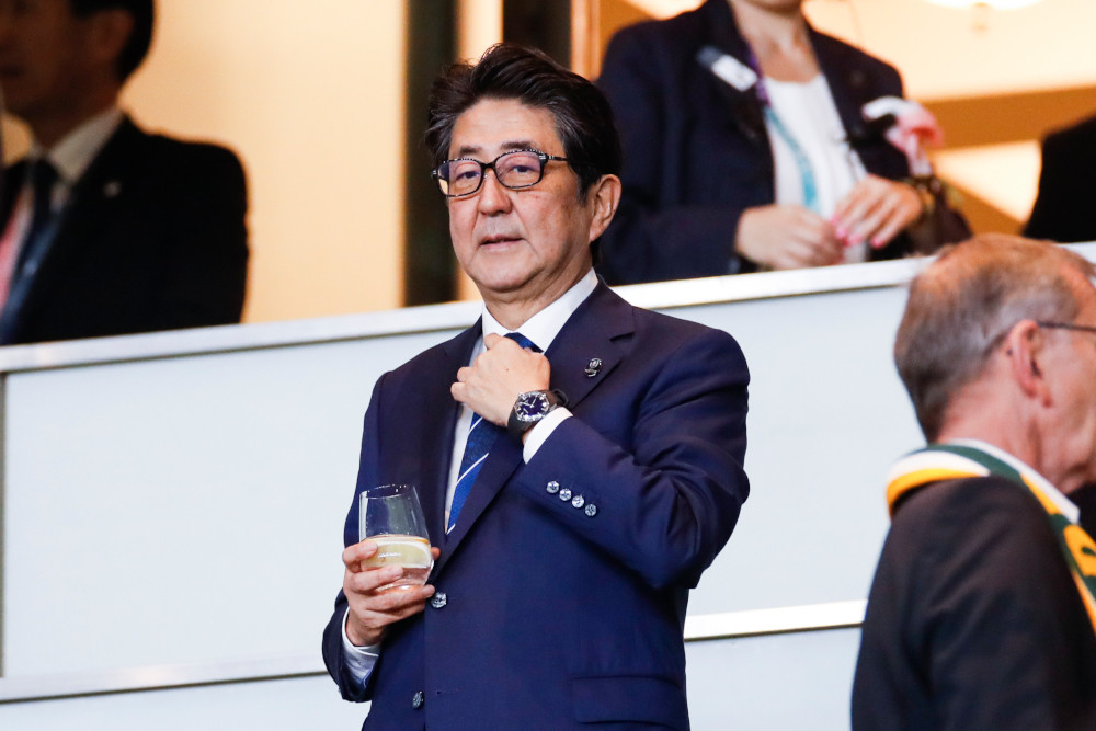 Japan's Abe ties record for longest-serving PM as allegations of misdeeds persist